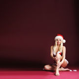 A blond woman posing in erotic Santa lingerie Stock Photos