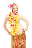 Blond woman posing in Hawaiian costume Stock Photos