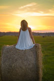 Blond woman posing at sunset time on a field Royalty Free Stock Photo