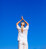 Blond woman practicing yoga Royalty Free Stock Images