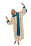 Blond Woman Praising God. Woman in church choir robe with her arms raised in charismatic praise to God.  Shot isolated on white background.  Horizontal Royalty Free Stock Photo