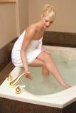 Blond woman preparing bath Stock Photos