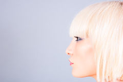Blond woman profile. Portrait of blond woman profile royalty free stock photo