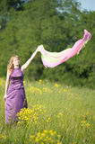 Blond woman in a purple dress Royalty Free Stock Photos