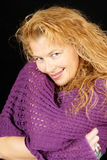Blond woman with purple scarf Stock Image