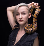 Blond woman with python Royalty Free Stock Images