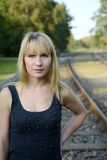 Blond woman on rail track Royalty Free Stock Photo