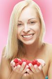 Blond woman with raspberries Royalty Free Stock Photos