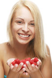 Blond woman with raspberries Stock Photography