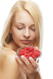 Blond woman with raspberries Royalty Free Stock Photo