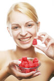Blond woman with raspberries Royalty Free Stock Image