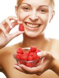 Blond woman with raspberries Royalty Free Stock Images