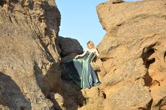 Blond woman in the ravine Royalty Free Stock Photos