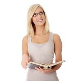 Blond woman reading book Royalty Free Stock Photo
