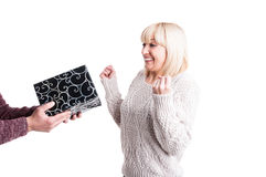 Blond woman receiving present acting joyful Stock Photography
