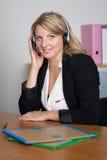 Blond woman receptionist Stock Photo