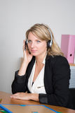 Blond woman receptionist in a business place Royalty Free Stock Photography