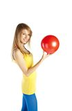 Blond woman with red ball Royalty Free Stock Photography