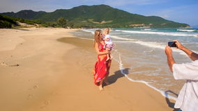 Blond Woman in Red Clasps Daughter to Breast Grandpa Photos stock footage