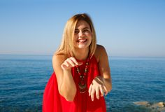 Woman in red. Blond woman in the red dress at the beach in Cyprus Royalty Free Stock Photography