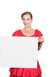 Blond woman in red dress Stock Photo