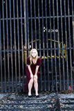 Blond Woman Red Dress Outdoors Railroad Tracks Stock Image