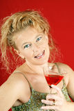 Blond woman with red drink Stock Image
