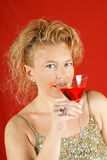 Blond woman with red drink Royalty Free Stock Image
