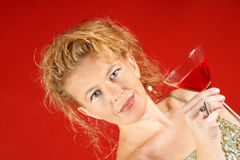 Blond woman with red drink Stock Photos