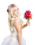 Blond woman with red flowers Royalty Free Stock Image
