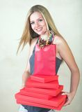 Blond woman with red gift stock photography