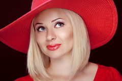 Blond woman with red lips wearing in hat, beautiful fashion girl Royalty Free Stock Photo