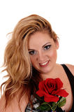 Blond woman with red rose. Stock Photo