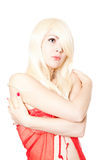 Blond woman in red top posing against white Royalty Free Stock Image