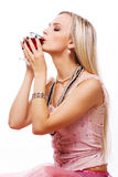 Blond woman and red wine. Young luxurious blond woman in pink dress drinking red wine Stock Photo