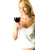 Blond woman with red-wine. Young attractive happy smiling blond woman with red-wine glass, isolated on white background Royalty Free Stock Images