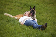 Blond woman relaxing with her dog Stock Photo
