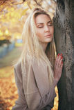 Blond woman relaxing outdoor Royalty Free Stock Photography