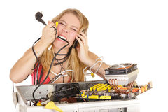 Blond woman repairing computer Stock Image