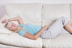 Blond woman resting Royalty Free Stock Images