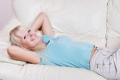 Blond woman resting Stock Images