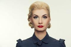 Blond woman in retro dress Stock Photo
