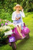 Blond woman on a retro roller Stock Images