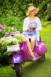 Blond woman on a retro roller Stock Photo