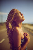Blond woman on the road Royalty Free Stock Image