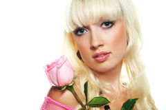 Blond woman with a rose Stock Images