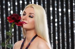 Blond woman with a rose Royalty Free Stock Photography