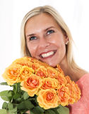 Blond woman with roses Royalty Free Stock Photography