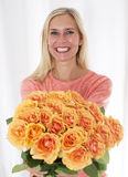 Blond woman with roses Stock Images