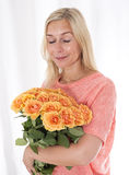 Blond woman with roses Royalty Free Stock Image